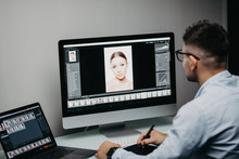 Professional Photographer Works In Photo Editing App Software On His Personal Computer. Photo Editor Retouching Photos Of Beautiful Girl.