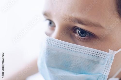 Fototapety, obrazy: Sad boy in medical protective mask. Child during coronavirus epidemic