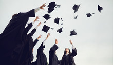 A Group Of Graduates Throws Ha...