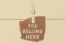 You Belong Here    A Paper On The Pegs. And This Is The Word Written.
