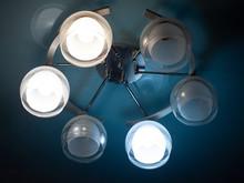 A Chandelier With Light Bulbs ...