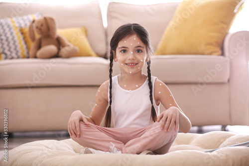 Adorable little girl with chickenpox at home Wallpaper Mural