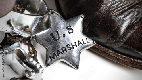Fototapeta Western themed United States Marshall badge with cowboy boots and spurs