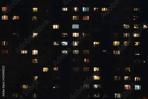 Apartment building at night. People staying at home Canvas Print