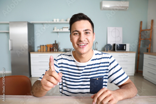 Young man using video chat at home
