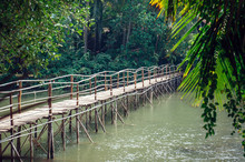 Old Wooden Bridge Over A Small...