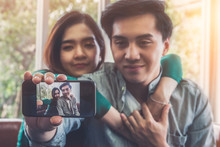 Happy Asian Couple Enjoy Takin...