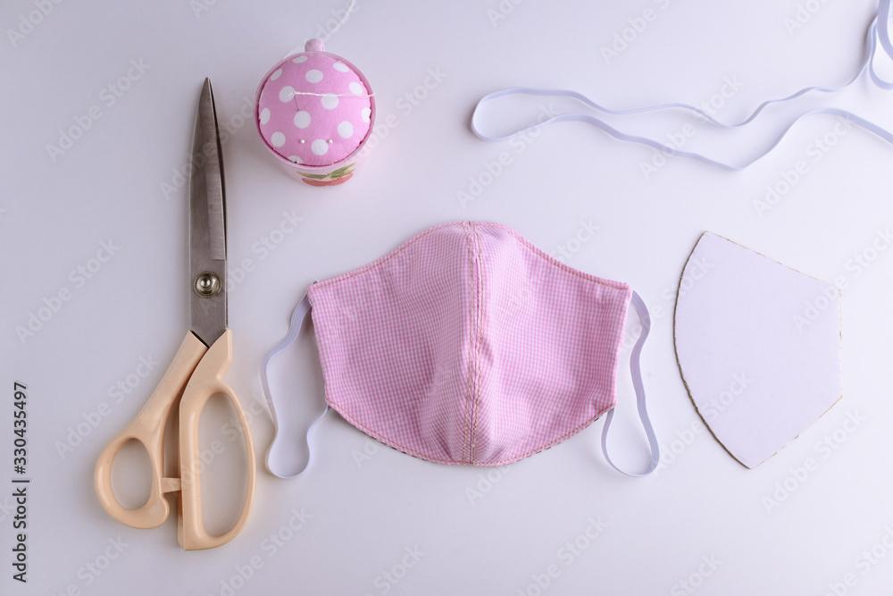 Fototapeta fashion face mask handmade from fabric cotton