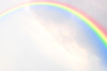 A Rainbow In Many Clouds With ...