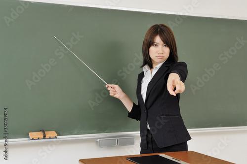 Photo 厳しく教える女教師