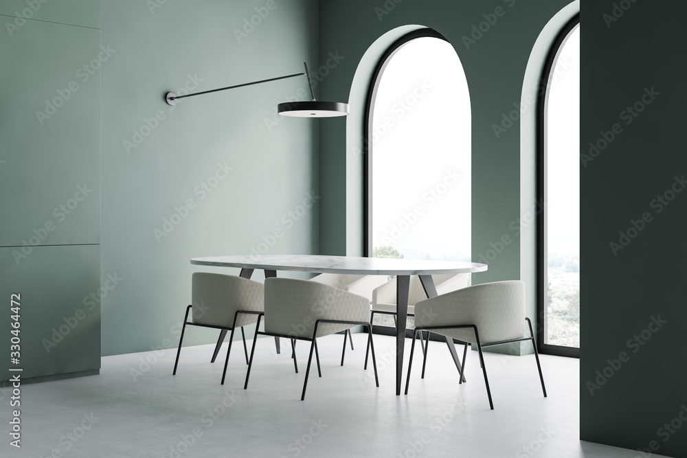 Fototapeta Green dining room corner with arched windows