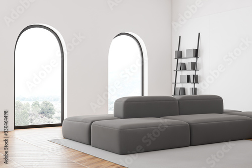 Obraz Arched window living room corner with sofa - fototapety do salonu