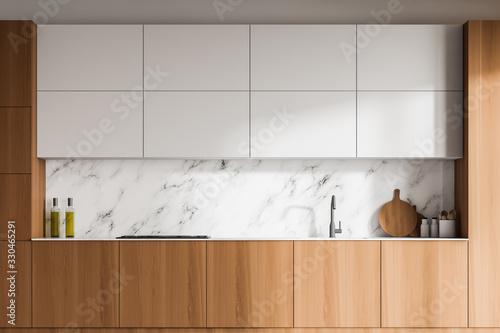 Obraz White marble kitchen with wooden countertops - fototapety do salonu