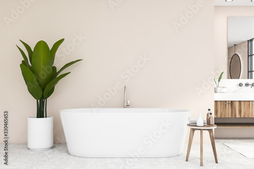 obraz dibond Bathtub and sink in beige bathroom