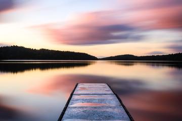 Fototapeta Wschód / zachód słońca Jetty into lake at sunrise. Gothenburg, Sweden
