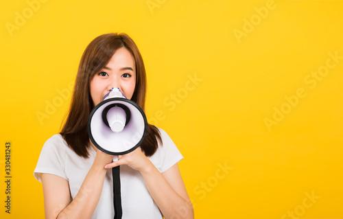 woman teen standing making announcement message shouting screaming in megaphone Wallpaper Mural
