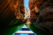 Wooden Boat On A River Surroun...
