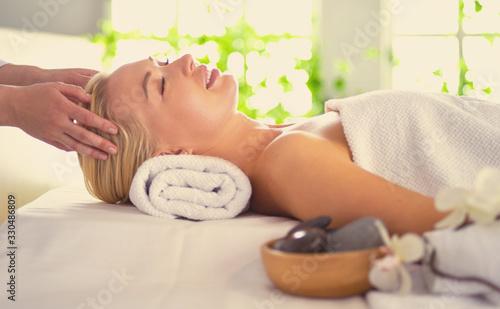 Fototapeta Beautiful young woman lying in spa salon obraz