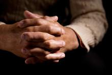 Hands Praying On Black Backgro...