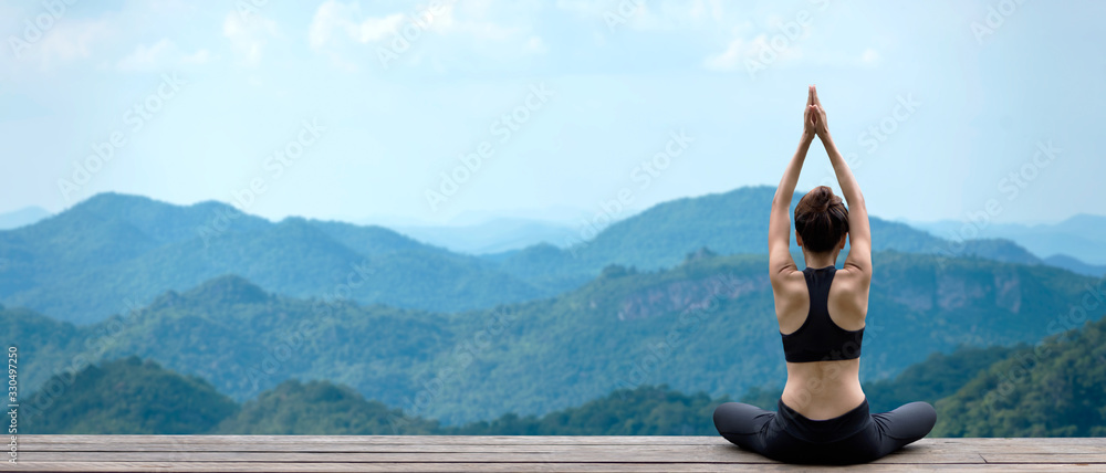 Fototapeta Lifestyle woman yoga exercise and pose for healthy life. Young girl or people pose balance body vital zen and meditation for workout nature mountain background in morning day. Copy space for banner.