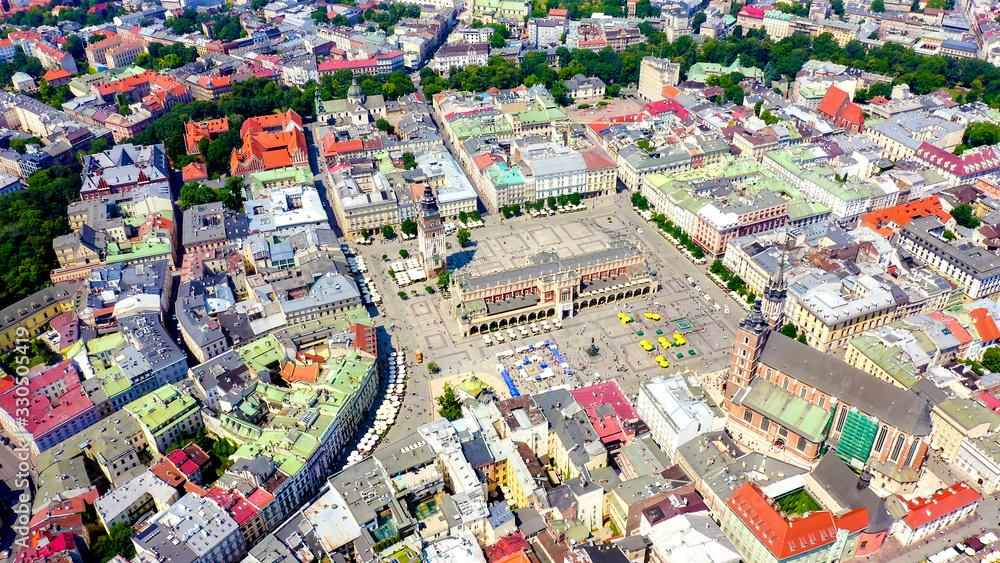 Fototapeta Krakow, Poland. Main Square. Big city square of the 13th century. View of the historic center, Aerial View - obraz na płótnie
