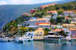 Soft focus and tilt shift blur. Colorful Asos village at Kefalonia island. Greece. Popular destination on Ionian Sea for vacation. Mediterranean port for traveling by yacht and honeymoon paradise