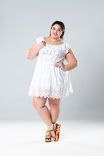 Plus Size Fashion Model In White Dress, Fat Woman On Gray Background, Body Positive Concept