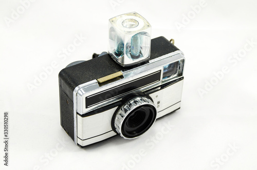 Vintage camera with disposable flash bulb on a white background Canvas Print