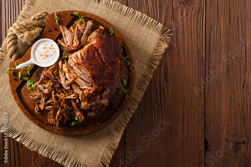 Pulled pork on a wooden board. Top view. Wallpaper Mural