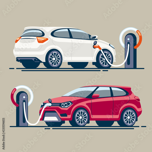 Two electric cars at a gas station are charged with electricity through an electric cable with a connector Canvas Print