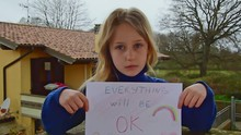 Sad Little Caucasian Girl Hold...