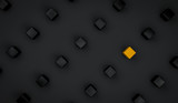Futuristic background of black cubes suspended in air with one yellow cube in the middle