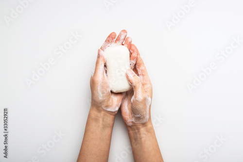 Fotografia Health care hygiene protection against virus, bacteria, flu and coronavirus by washing hands with soap