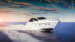canvas print picture - Luxurious motor boat sailing the sea at sunset