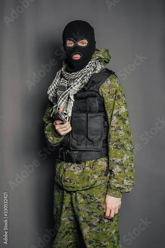Obraz na plátne A member of the special police squad, takes aim, holds a pistol