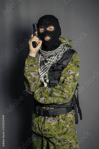 Fotografia, Obraz A member of the special police squad, takes aim, holds a pistol