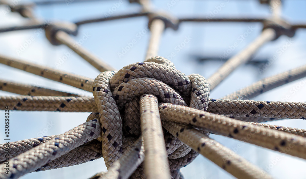 Fototapeta many ropes and one big knot close up