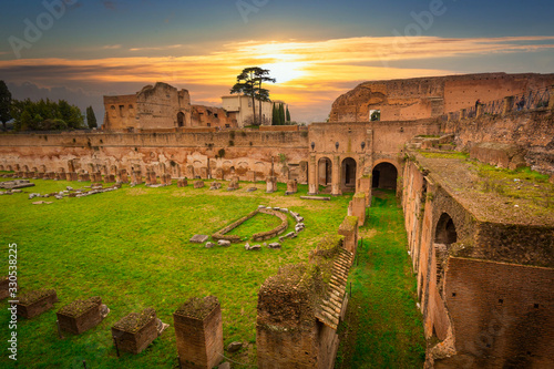 Fototapeta Ruins of the Hippodrome of Domitian in ancient Rome at sunset, Italy