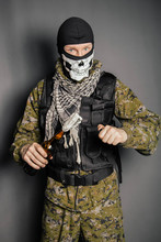 A Man In A Balaclava With A Sk...
