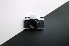 Vintage Camera On Black And White Background. Retro Style Toned Picture. Minimalistic Concept