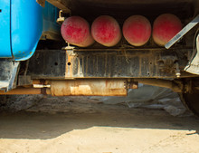 Truck With Red Gas Cylinders On The Sand