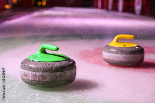 Cuadros en Lienzo curling stones on ice near the home colorful background
