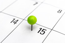 Green Pinned Pin In Calendar On 15th Day.