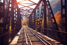 Old Railway On The Bridge Over The Mountain River In Autumn