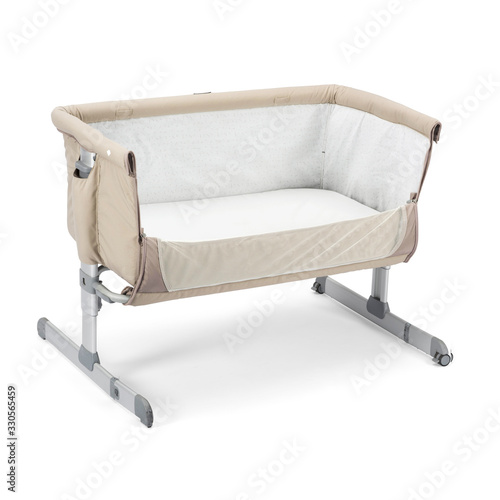Photo Beige Travel Cot Isolated on White
