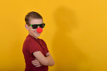 A Serious Boy With A Clown Nos...