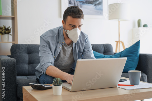 Man working from home and worried about covid-19 coronavirus Billede på lærred