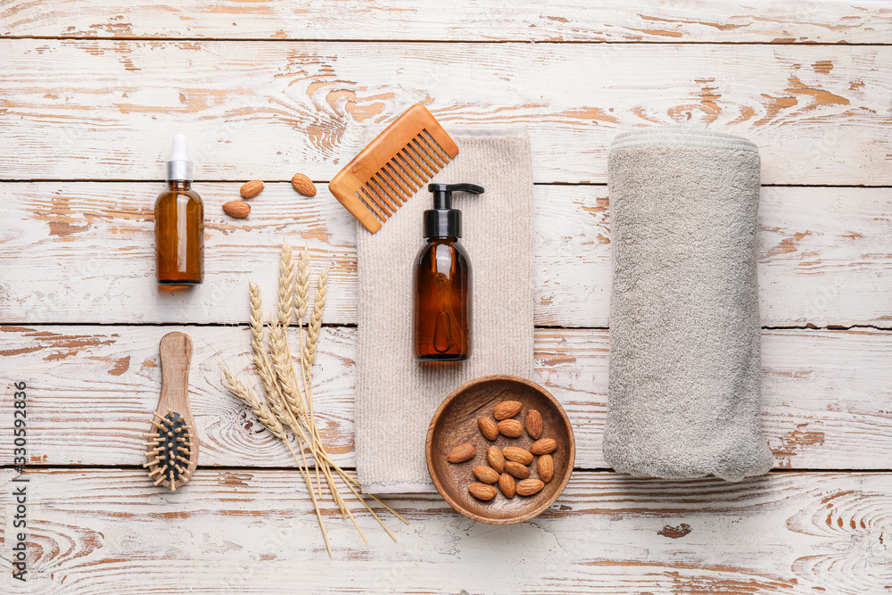 Fototapeta Composition with shampoo and natural ingredients on wooden background