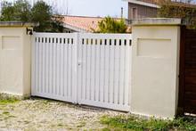 Suburban Metal Gate White Fence On Home Suburb Street Access House Garden
