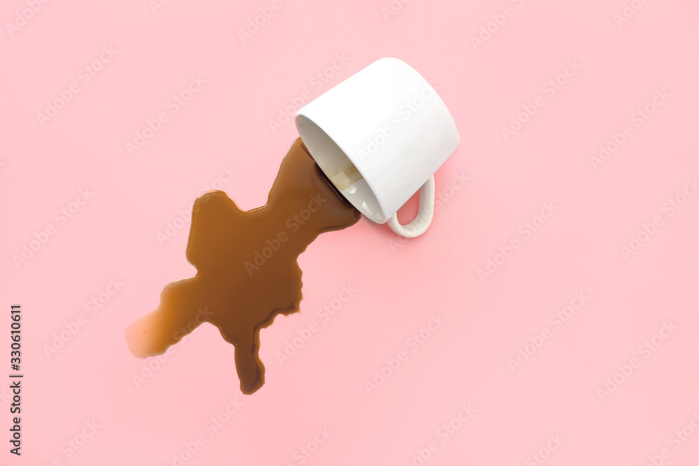 Fototapeta Overturned cup of coffee on color background
